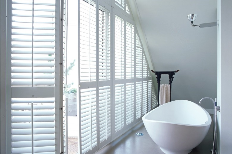 white wooden shutters without center tiltrod also known as silentview