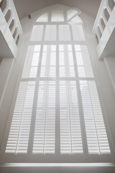 white round shutters over 6 meters high