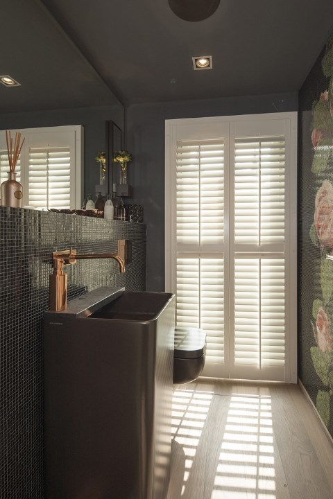 white shutters with center tiltrod in bathroom with washing sink